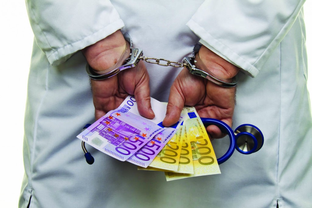 Physician with Euro bank notes and handcuffs